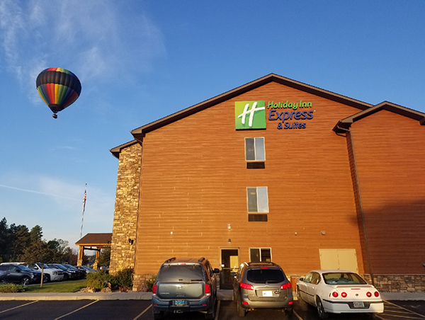hot air balloon rising next to the Holiday Inn Express